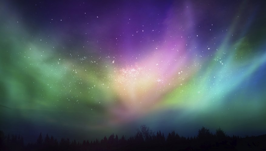 Charged particles colliding with atmospheric gases produce the aurora.