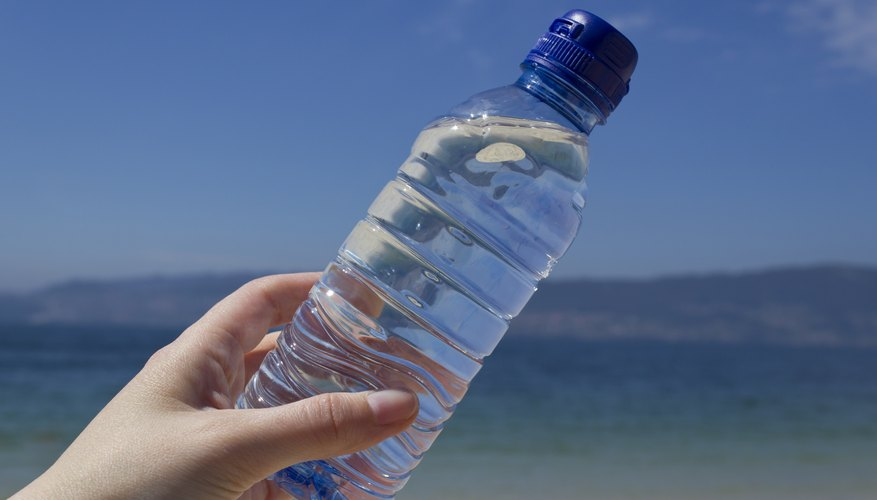 Close-up of bottled water at the beach