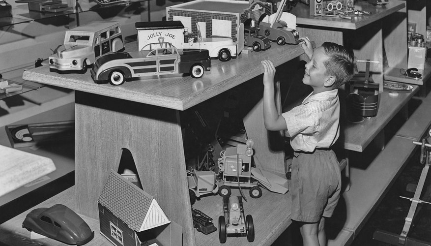 A small boy inside a toy store in the 1950's
