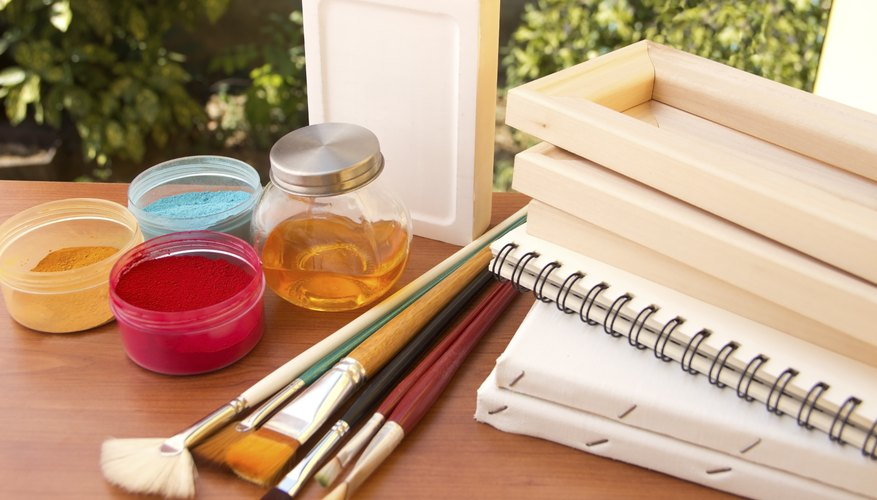 A variety of painting supplies on an outdoor table.