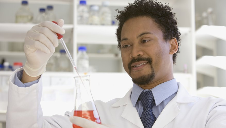Chemist working with sample in laboratory.