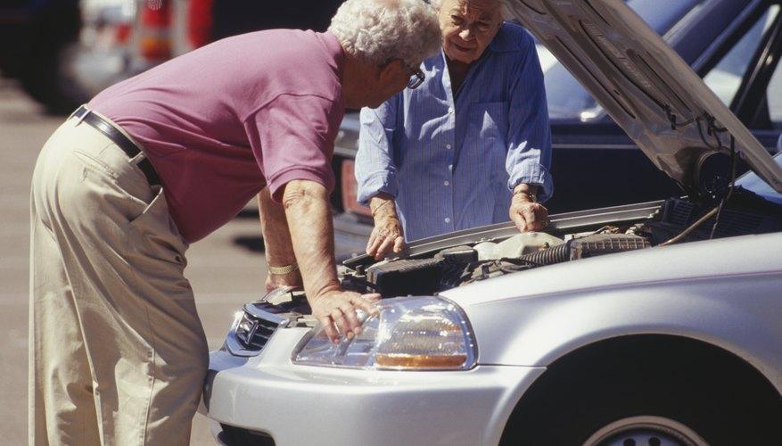 Senior couple with broken down car