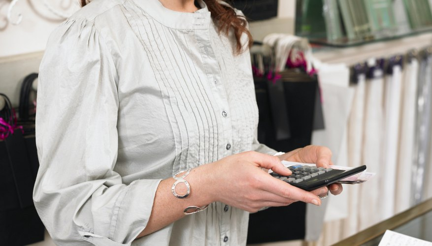 Woman using calculator at retail store