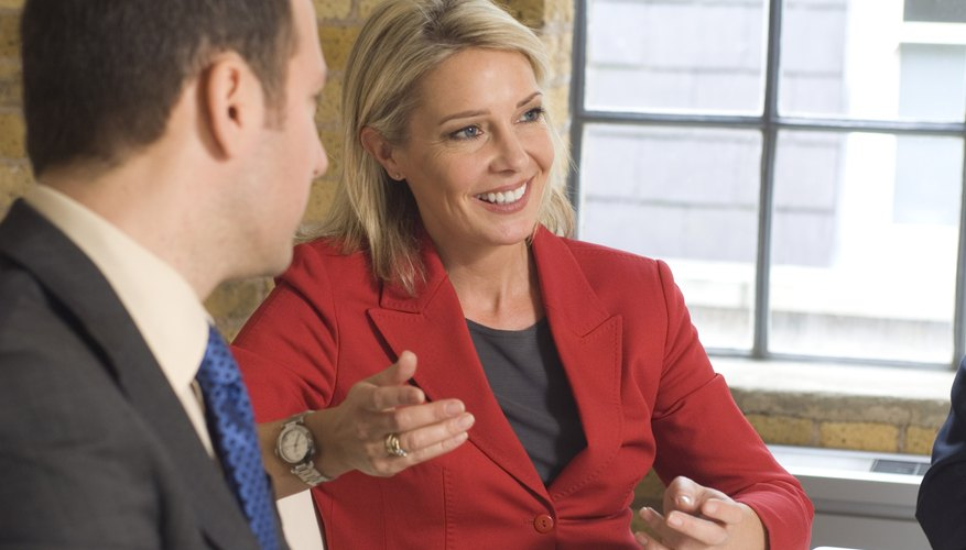 Businesswoman with a businessman talking in a meeting