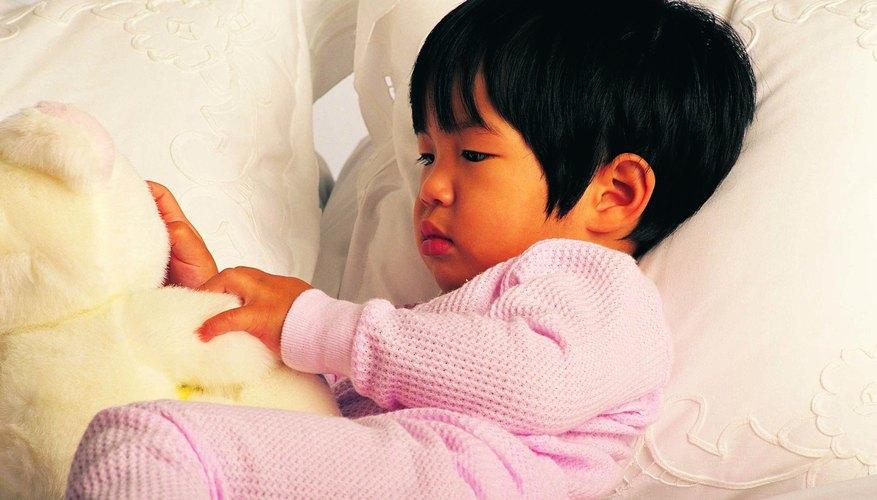 toddler laying in toddler bed