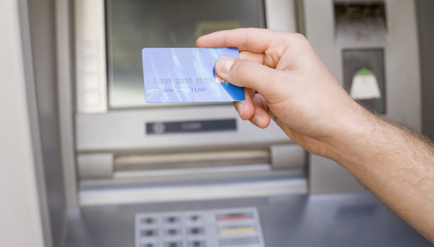 Person holding bank card