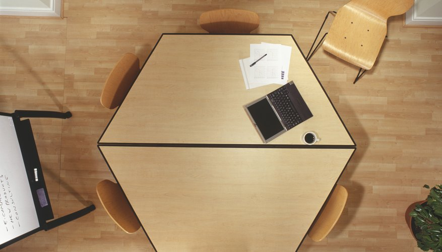 Hexagonal conference table in office, overhead view