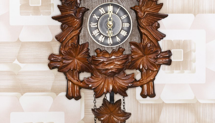 Traditional nature scene carved on a Black Forest cuckoo clock.