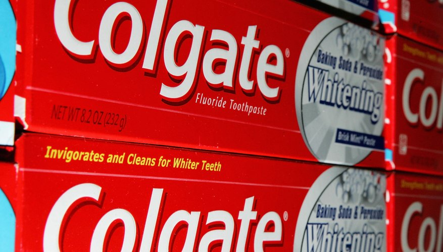 Close-up of Colgate toothpaste boxes.