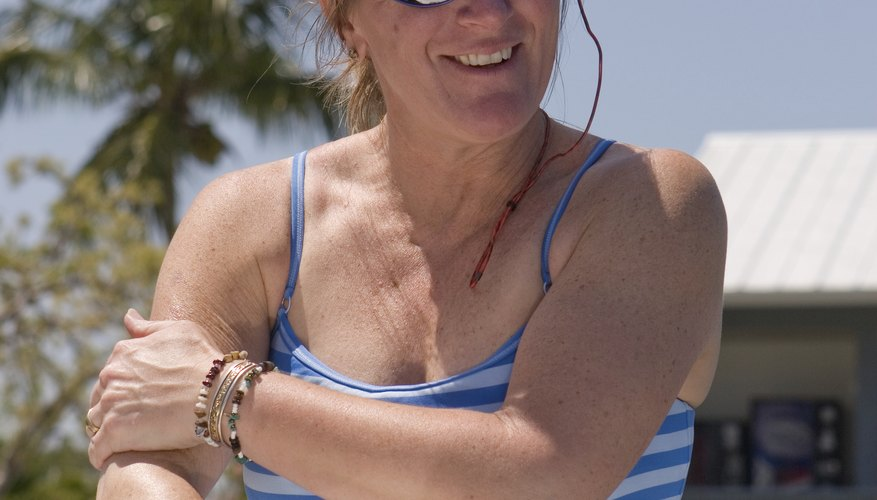 Woman rubs repellent on arm