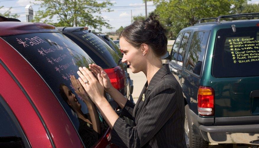 Woman looking at SUV