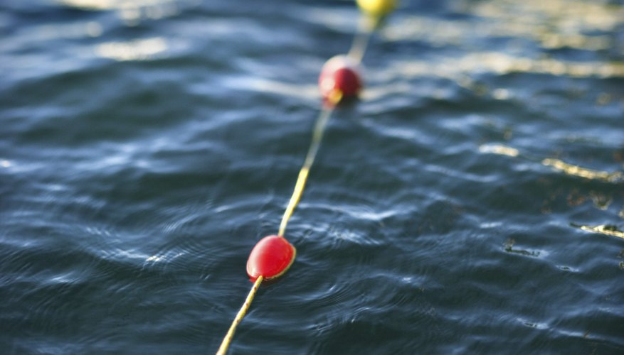 Buoys float because their density is less than that of water