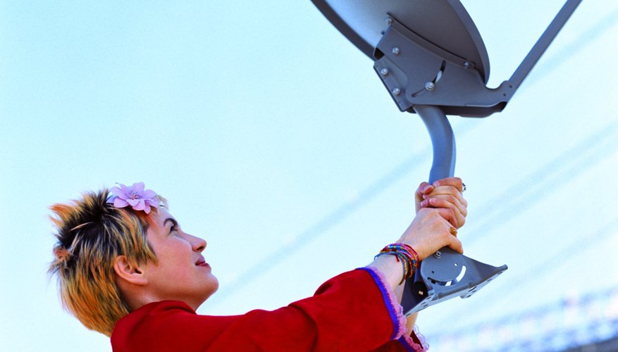 Woman with satellite dish