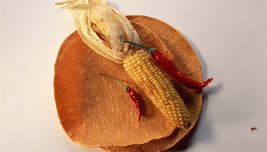 Red corn tortillas with chili peppers and corn