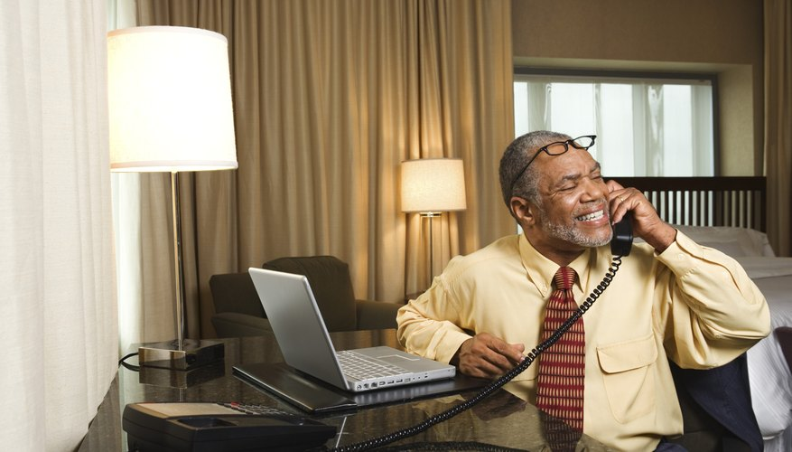 Businessman on telephone in hotel room