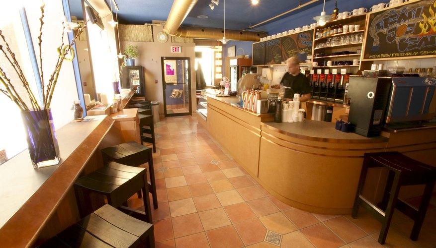 Barista in empty coffee shop