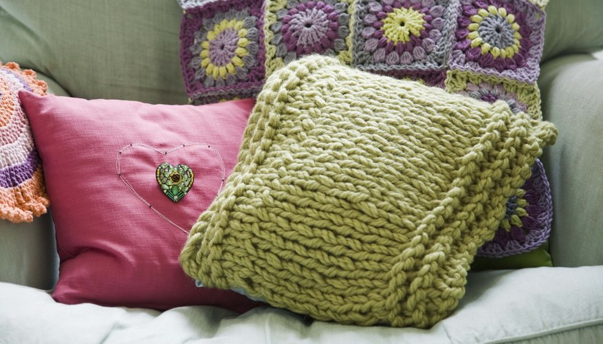 Use different fabrics to make an array of pillows.