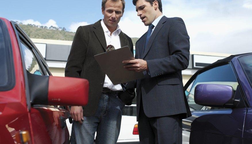 Men talking by car