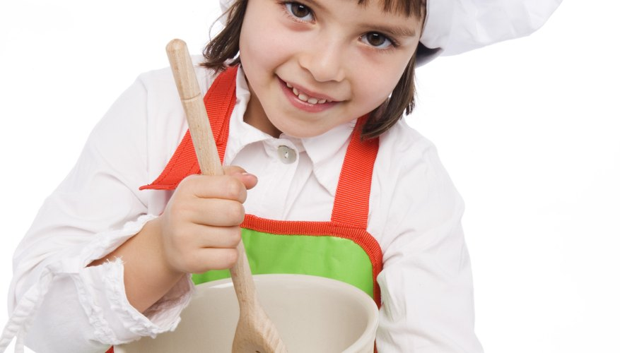 Take pictures of your child as she makes the recipes for her cookbook.