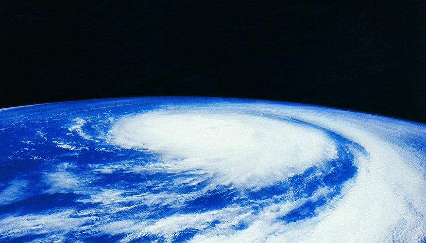 A view from space shows a hurricane building over the Pacific Ocean.