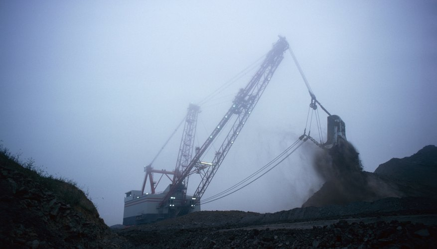 Excavaters remove coal from a mine.