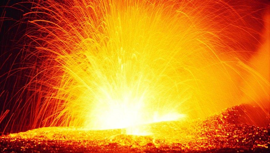 A volcano spews hot lava.