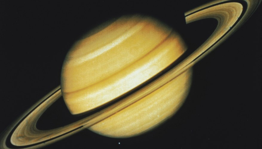 As the helium and hydrogen seperate on Saturn, the friction creates heat.
