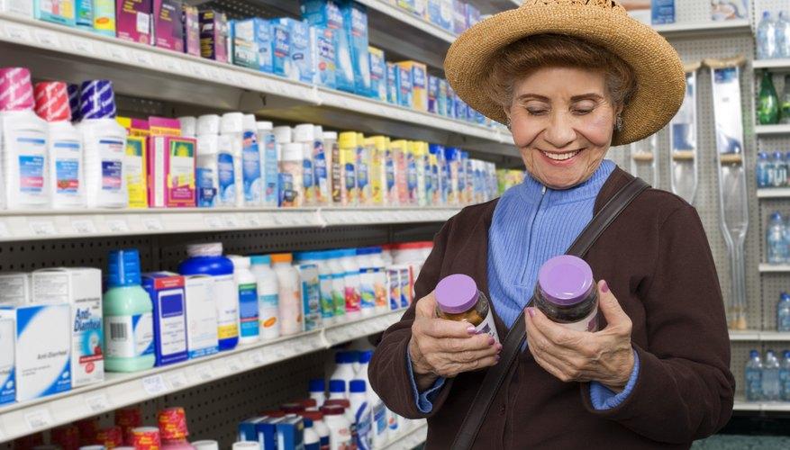 Customer looking at bottles of medication