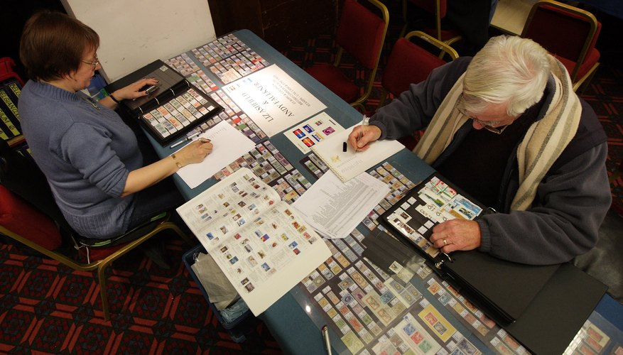 Collectors look through books of stamps