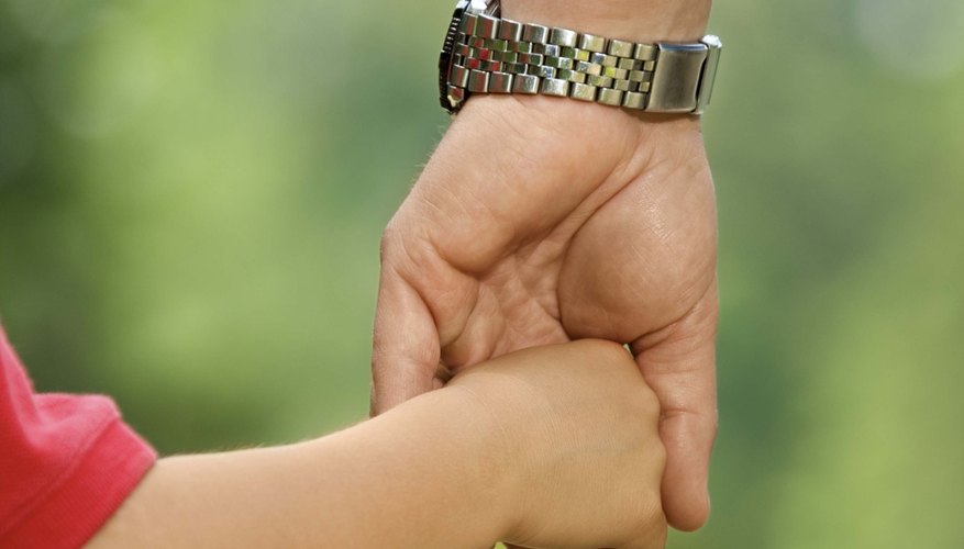 Holding your child's hand can help make him feel secure.
