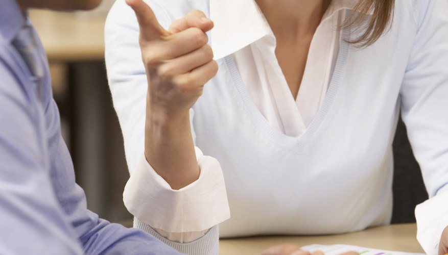 Businesswoman arguing with coworker