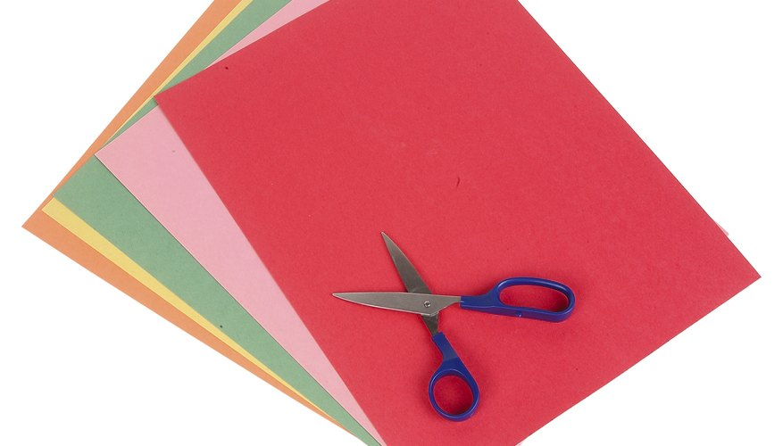 Make colorful butterflies using construction paper.