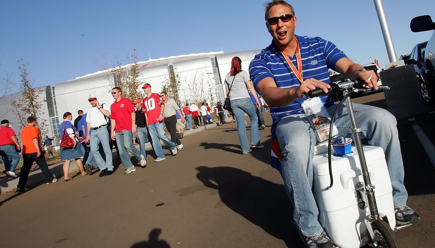 Football fan driving around parking lot with motorized cooler