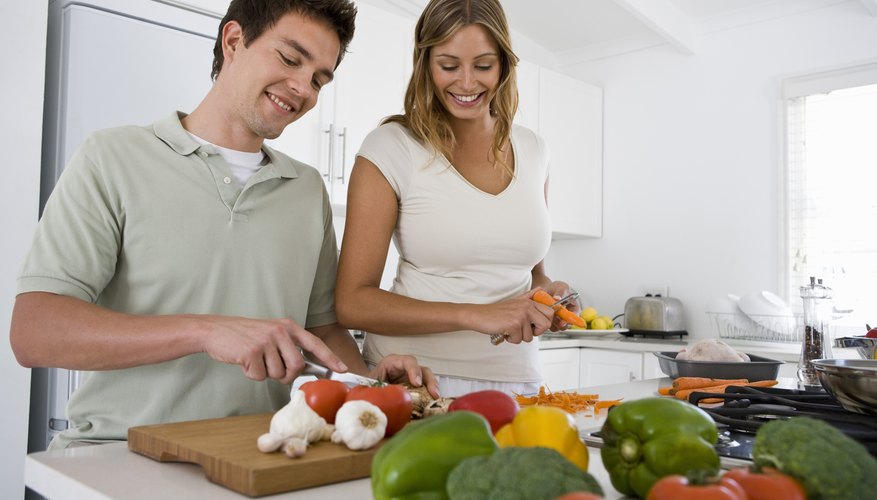 Young couple making food recommended by the Herbalife diet