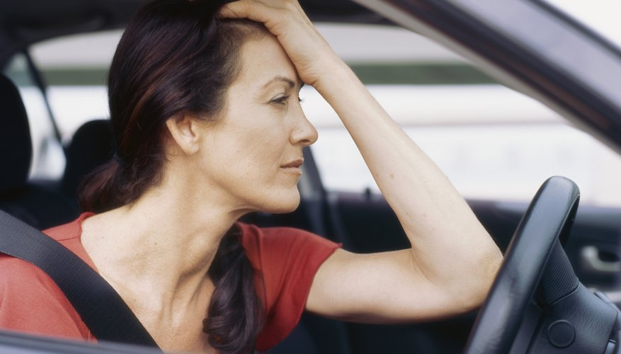 Side profile of a mid adult woman in her car