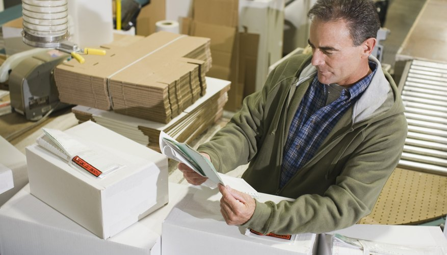 Warehouse worker reading document