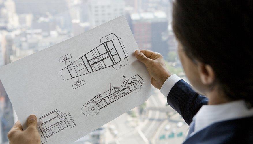 Businessman with car design plans