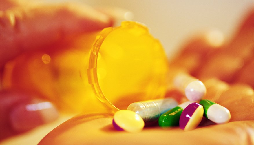 Various pills in a woman's hand