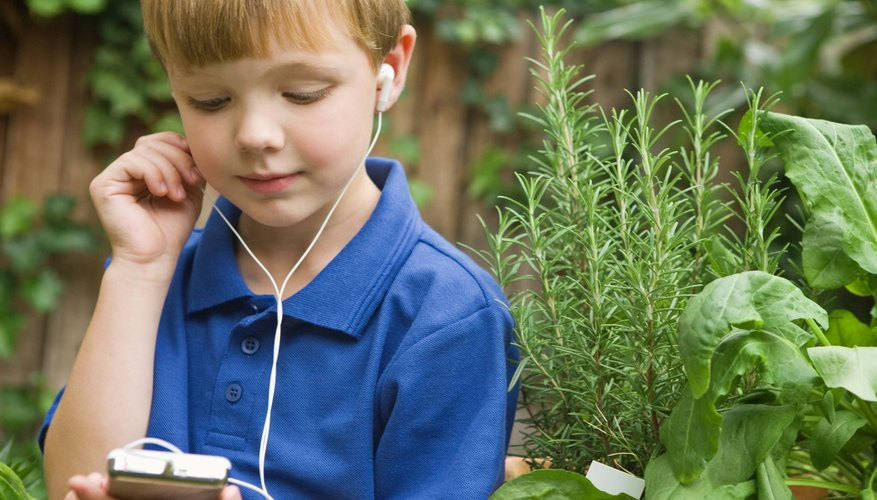 Load an electronic device with pleasant music or engaging stories.