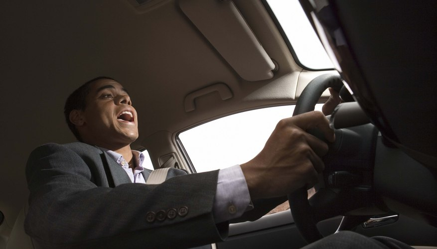 Businessman singing while driving