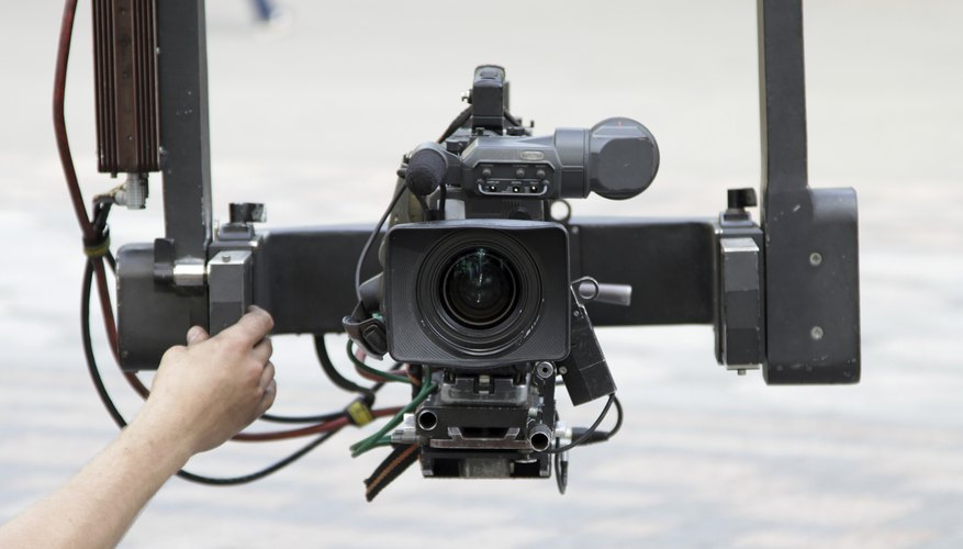 A close-up of a video camera mounted onto a crane to capture an outdoor shot.