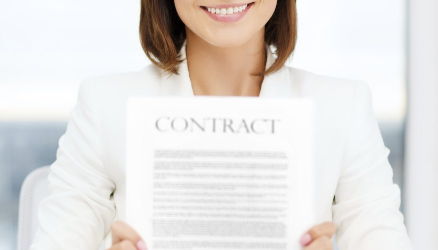 happy businesswoman holding contract