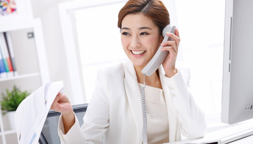 Young business lady making phone call