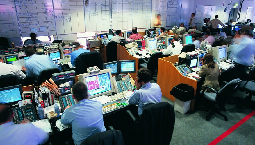 Stock brokers working at stock exchange