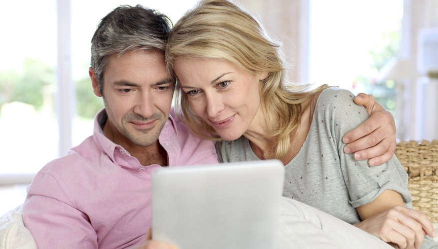 40 year old couple looking at document