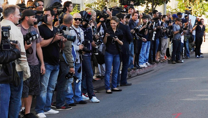 The paparazzi waits for a celebrity's arrival.