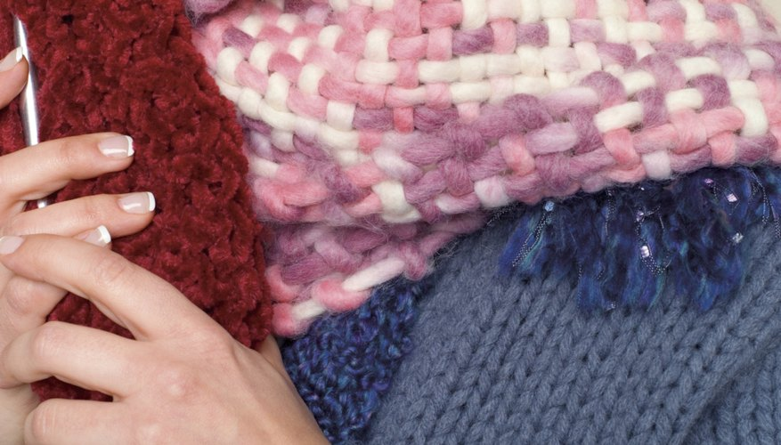 Use a Knifty Knitter to create a handmade scarf.