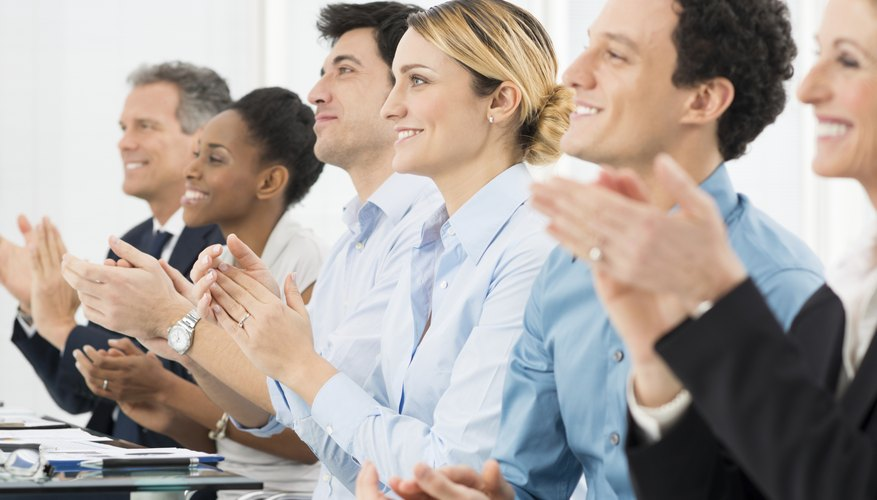 Businesspeople Clapping In Office