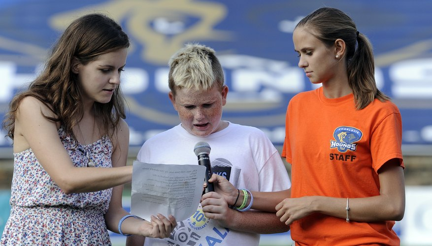 A boy with autism sings the national anthem.