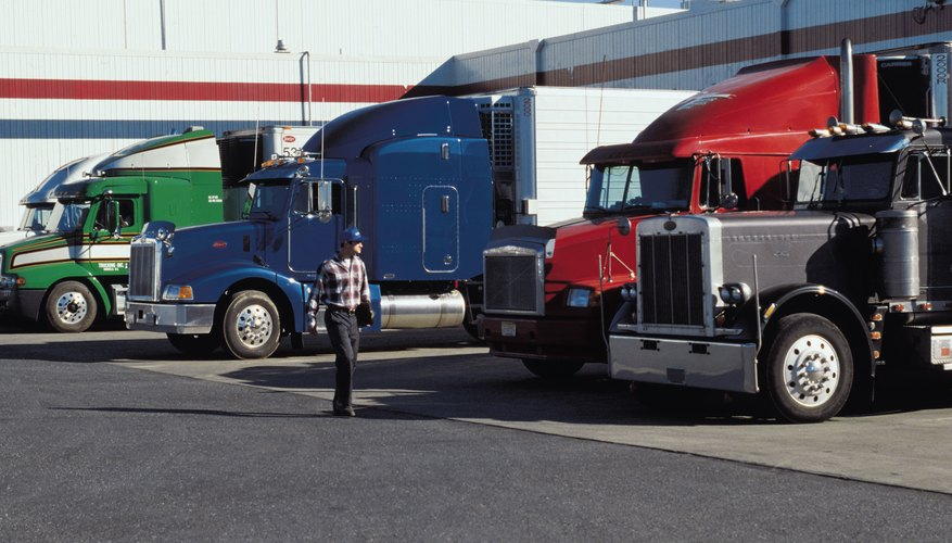 Tractor trailers at fuel station or loading dock